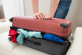 Hands Trying To Close Suitcase — Stock Photo