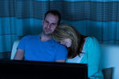 Couple On Sofa Watching Television — Stock Photo