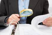 Businessperson Checking Bills — Stockfoto