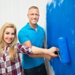 Young Couple Painting Wall — Stock Photo #71490741