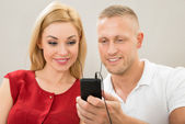 Couple Listening To Music — Stock Photo
