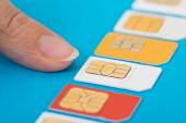 Hand Selecting Sim Card — Stock Photo