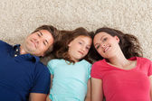 Family Lying On Rug — Stock Photo