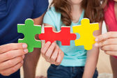 Family Joining Puzzle Pieces — Stock Photo