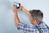 Technician Adjusting Cctv Camera — Stock Photo