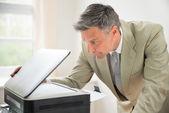 Businessman Looking At Photocopy Machine — Stock Photo