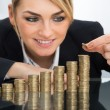 Businesswoman Putting Coin — Stock Photo #72097683
