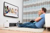 Couple Watching Television In Living Room — Stock Photo