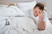 Depressed Man On Bed — Stock Photo