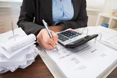 Businessperson Calculating Bills — Стоковое фото