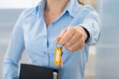 Businesswoman With Key And Folder — Stock Photo