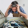Electrician Looking At Fuse Box — Stock Photo #73539093