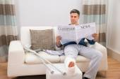 Disabled Man Reading Newspaper — Stock Photo