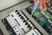 Technician Repairing Fusebox — Stock Photo