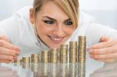 Businesswoman Putting Coin — Stock Photo