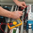 Electrician Checking Fuse Box — Stock Photo #74130945