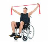 Disabled Man On Wheelchair With Resistance Band — Stock Photo
