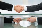 Businessman With Money Handshaking — Stock Photo