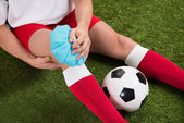 Soccer Player Icing Knee — Stock Photo