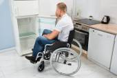 Disabled Man Look Into Refrigerator — Stock Photo