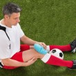 Player Icing Knee With Ice Pack — Stock Photo #74747117