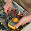 Electrician Checking fuse Box — Stock Photo #74747885