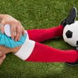 Soccer Player Icing Knee With Ice Pack — Stock Photo #74747961