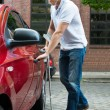 Handicapped Man Opening Car — Stock Photo #74747967