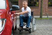 Handicapped Man Opening Door — Stock Photo