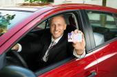 Businessman Showing Driving License — Foto Stock