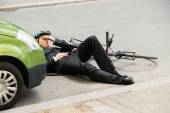 Male Cyclist Lying On Road — Stock Photo