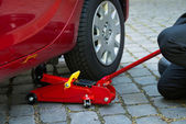 Car Lifted With Hydraulic Floor Jack — Stock Photo