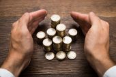 Businessman Hand Protecting Euro Coins — Stock Photo