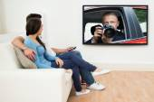 Couple watching Television — Stock Photo