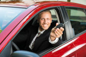 Businessman Showing Car Key — Stock Photo