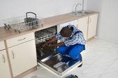 Repairman Repairing Dishwasher — Stock Photo
