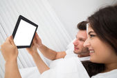 Couple Looking At Digital Tablet — Stock Photo