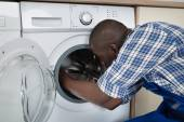 Technician Repairing Washing Machine — 图库照片