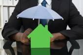 Businessman Protecting House Model — Stock Photo