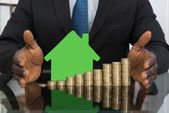 Businessman With House Model — Stock Photo