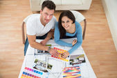 Couple Choosing Color From Swatch — Stock Photo