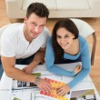 Couple Choosing Color From Swatch — Stock Photo #77887936