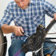 Young Man Fixing Bicycle — Stock Photo #77886420