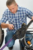 Young Man Fixing Bicycle — Stock Photo