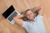 Man Lying With Laptop — Stock Photo