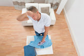Tired Man Ironing Clothes — Stock Photo