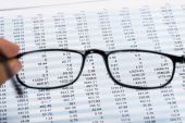 Financial Document and Eyeglasses — Stock Photo