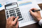 Businessman Doing Financial Calculations — Stock Photo