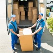 Workers Loading Boxes In Truck — Stock Photo #77903520