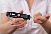 Hands Holding Glucometer — Stock Photo